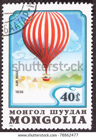 MONGOLIA - CIRCA 1982: A stamp printed in Mongolia commemorating Charles Green's 1836 balloon flight from Vauxhall Gardens in London to Weilburg, Duchy of Nassau a distance of 480 miles, circa 1982.