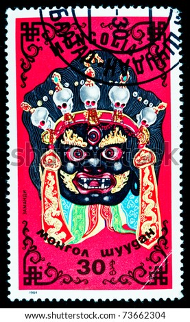 MONGOLIA - CIRCA 1984: A stamp printed in Mongolia showing mask of Ancient idol circa 1984