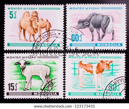 MONGOLIA - CIRCA 1968: A stamp printed in Mongolia shows four kinds of wild and home animals , circa 1968.