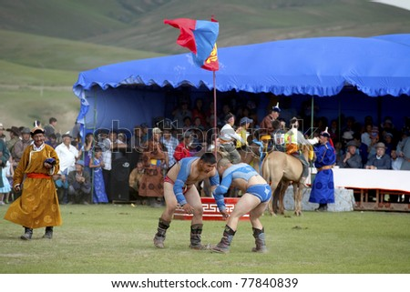 MONGOLIA - JULY 10: Annual Nadaam Festival,  traditional Mongolian wrestling on July 10, 2009 in Central Mongolia.