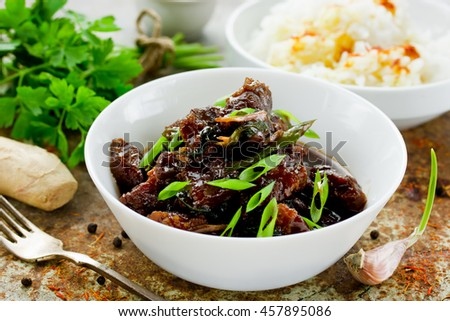 Mongolian meat - beef in dark spicy sauce in asian style selective focus