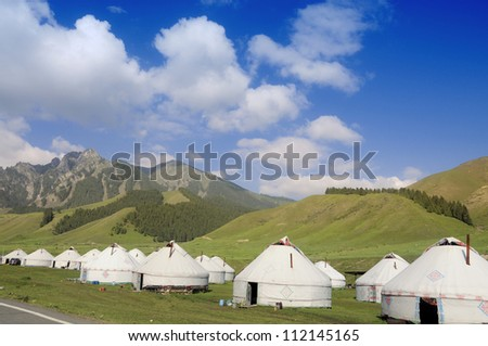 Mongolian yurts under the mountain and bluesky