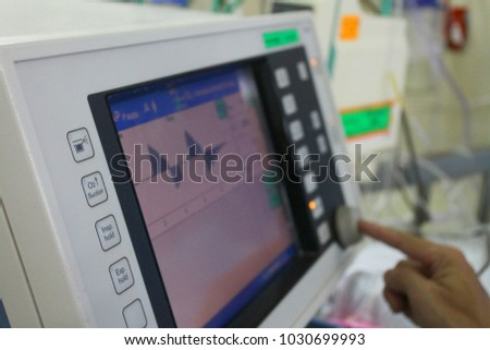 monitor control by hand in patient room  #1030699993