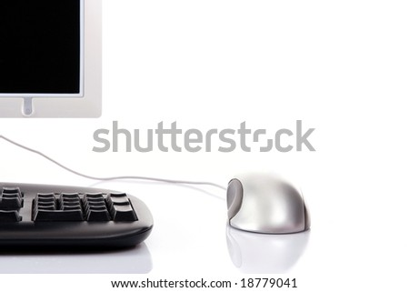 Monitor, keyboard, mouse on white background, close up