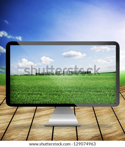 monitor on wood and nature background