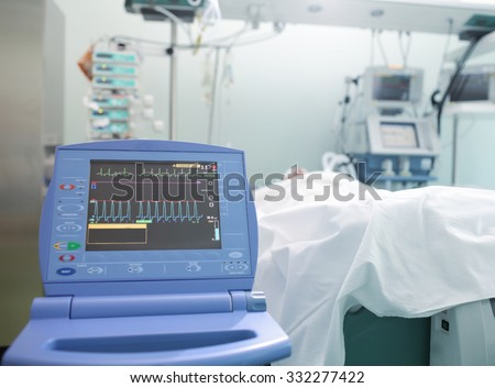Monitoring of cardiac function unconscious patient in ICU - Shutterstock ID 332277422