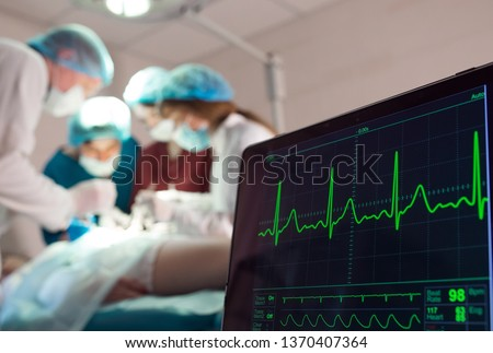 Monitoring of ECG and saturation O2 in the patient in the operating room #1370407364