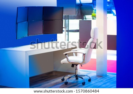 Monitoring the situation. Workplace of the dispatcher. Armchair in front of monitors. Blank screen. Concept - security in a business center. Dispatch center at the enterprise. Control Panel. #1570860484