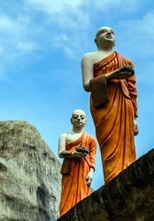 Monk buddhist walking on mountain, tourist attraction Sri Lanka