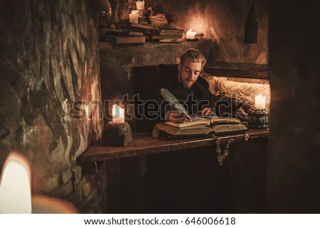 Pleasing Monk Writing In An Ancient Book With A Feather Quill Images Interior Design Ideas Ghosoteloinfo