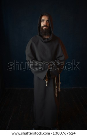 Monk in black robe with hood, religion ストックフォト ©