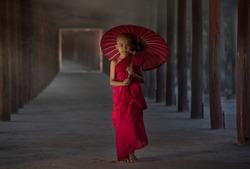 Monk Myanmar, Southeast Asian young little Buddhist monks walking morning alms in bagan, Myanmar