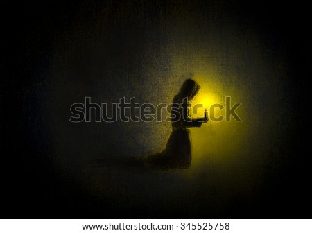 monk praying with a candle ストックフォト ©