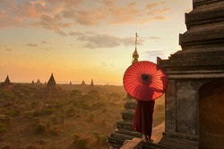 Monk relaxing in ancient temple on during sunset,Bagan Myanmar