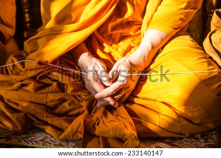 Monk\'s hand in Buddhism ceremony
