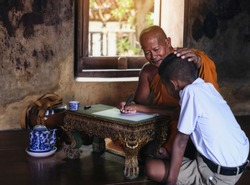 Monk teaching children books in rural temples.