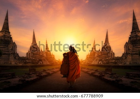 Monk walking at ayutthaya historical park, Ayutthaya Province in thailand.