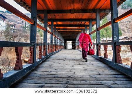 Monk walking towards Rinpung Monastery, Paro, Bhutan