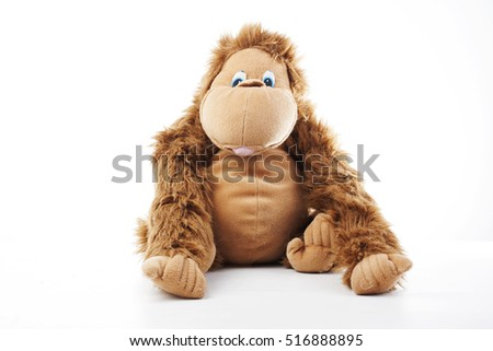 Monkey plush toy in studio. brown monkey,cute monkey,fake monkey,plush monkey,toy monkey,chimpanzee,jocko,gorilla,anthropoid,hominids,monkey toy,monkey plush,monkey with white background, #516888895