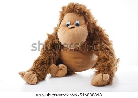 Monkey plush toy in studio. brown monkey,cute monkey,fake monkey,plush monkey,toy monkey,chimpanzee,jocko,gorilla,anthropoid,hominids,monkey toy,monkey plush,monkey with white background #516888898