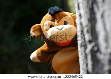 Monkey toy in a tree