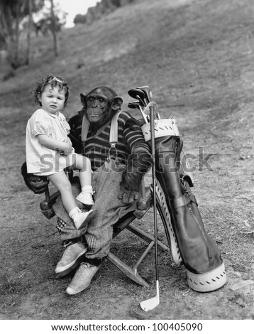 Monkey with golf clubs and toddler girl