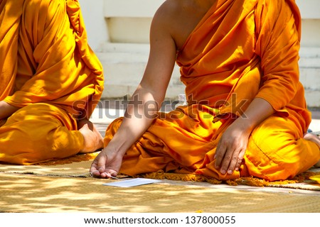 monks and religious rituals in thai temple