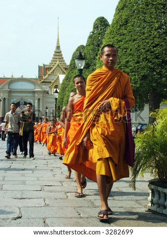 Monks at a temple in Thailand - travel and tourism