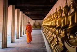Monks at Putthaisawan temple in Ayutthaya, Thailand.