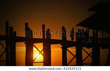 Sunset in U Bein bridge, Myanmar  U Bein bridge is longest