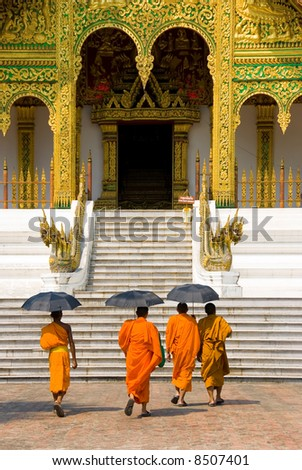 monks going to a temple, Luang Prabang, Laos