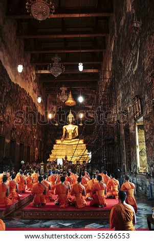 Monks prayed in the old temple with golden buddha at wat suthat Bangkok, Thailand