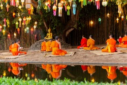 Monks prayer on Buddhas day under Banyan tree in Wat Phan tao temple Chiang Mai.