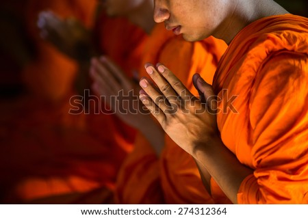 Monks Praying in Marble Temple of Bangkok, Thailand