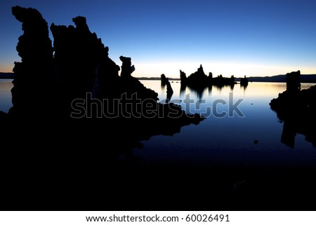 Mono Lake at sunrise with blue sky and copy space - stock photo