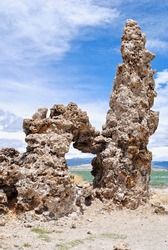 Mono Lake is a saline soda lake in Mono County, California. Many columns of limestone, called tufa, rise above the surface of Mono Lake. The Sierra Nevada Mountain Range is in the background.