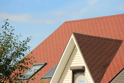 Mono-pitched roof with roofing and fencing. pent or lean-to roof