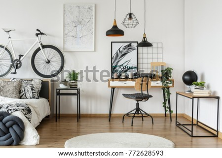Monochromatic open space apartment with wooden workspace in floral motif bedroom #772628593
