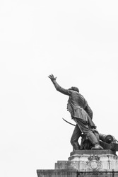 Monochromatic photo of the statue of the famous artillery captain named