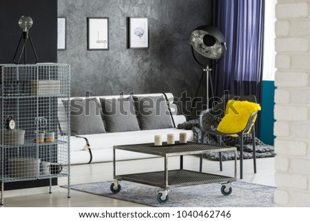 Monochromatic sitting room interior with industrial, designer furniture, paper tubes couch and colorful elements #1040462746