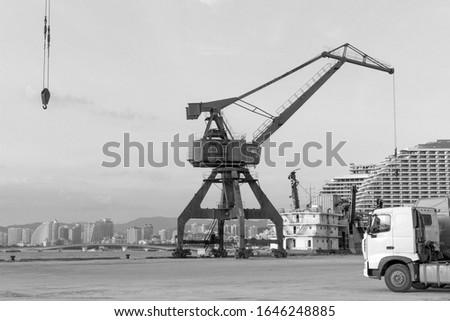 Monochrome background with gantry crane or portal crane in sea cargo port at Sanya, Hainan island, China