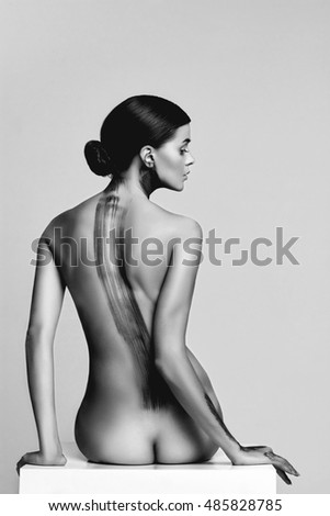 monochrome beauty portrait of beautiful sexy woman body painted paint. nude girl with body art