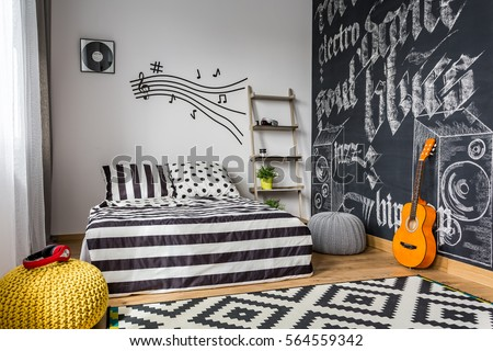 Monochrome bedroom interior for young guitar musician #564559342