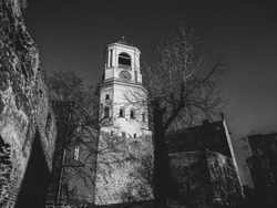 Monochrome black and white city landscape with Clock Tower and ruined walls in old Finnish city Vyborg, Russia Historic European medieval and classicism bell tower architecture