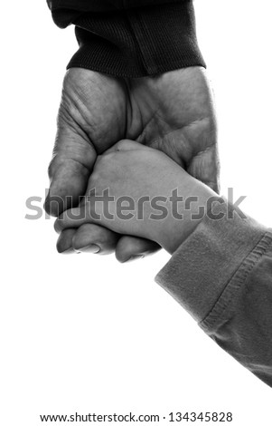 Monochrome closeup of an adult hand holding a child's hand on white