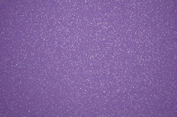 Monochrome dark purple surface with small silvery blotches. Background, pattern, texture.