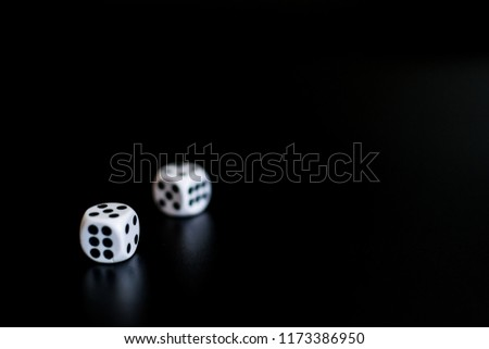 Stock Photo monochrome dice at the casino on a black background the result is 6.