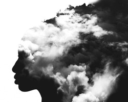 Monochrome double exposure of girl profile portrait and stormy cloudscape