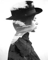 Monochrome double exposure of girl wearing hat profile and mountains