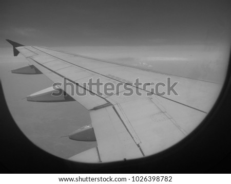 Monochrome from Airplane Window - Wing #1026398782
